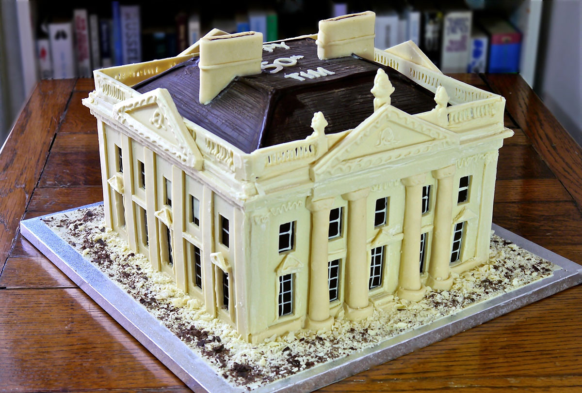 Beautiful white and dark chocolate Georgian Mansion architecture chocolate cake commission for a 50th birthday party