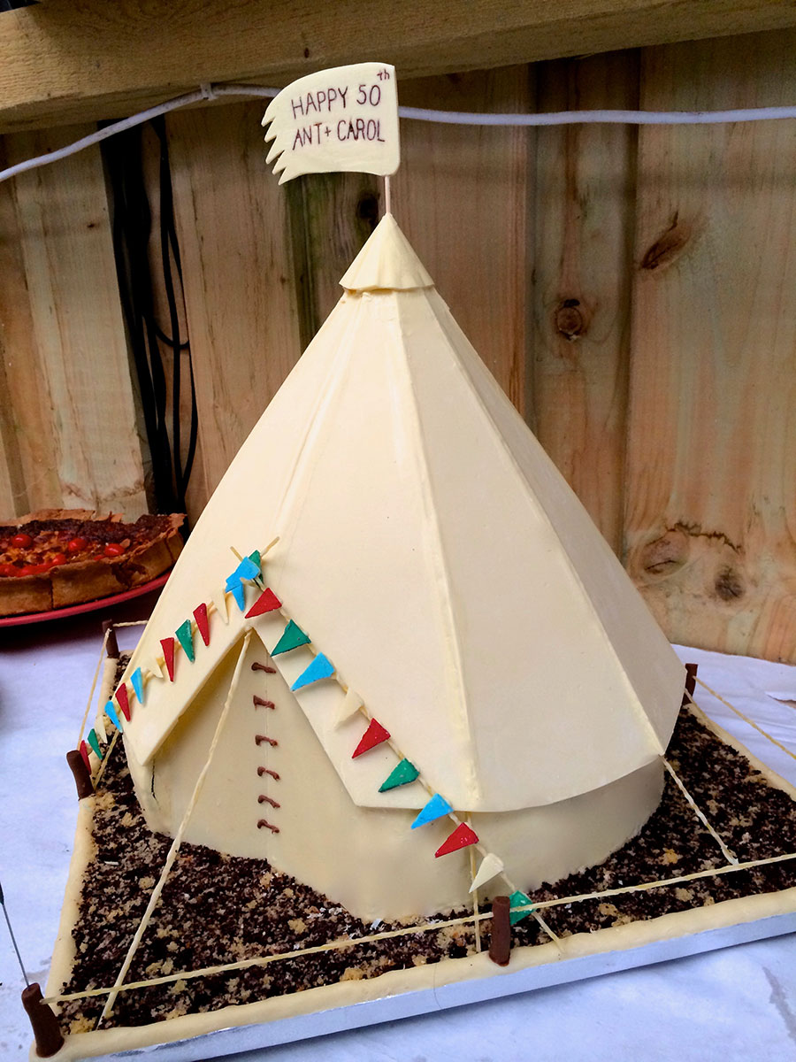 white chocolate tipi tepe teepee standing 3 foot tall for a couples sharing their 50th birthdays. decorated with coloured chocolate bunting ]