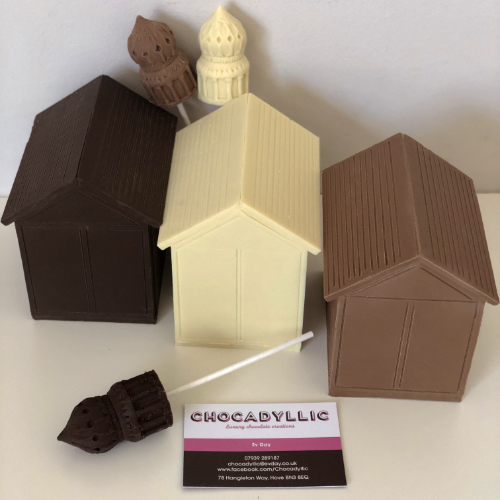 3 milk, dark, white hot chocolate royal Brighton pavilion lollipops and 3 hove beach huts in single flavour chocolate