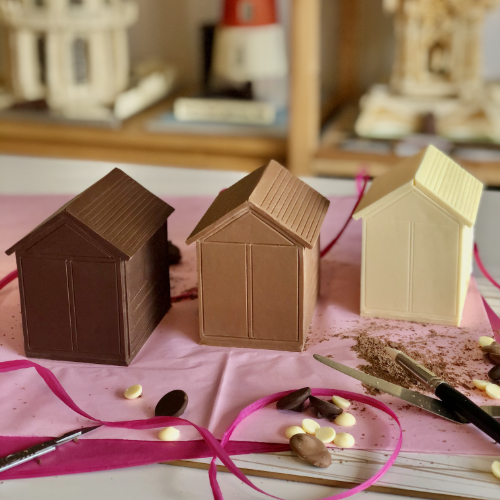 Three cute little 7cm tall Brighton beach huts in single flavour chocolate of milk, white and dark