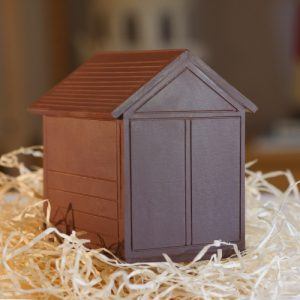 Brighton Beach Huts - single flavour dark chocolate Hove Actually 7cm tall - on a bed of straw