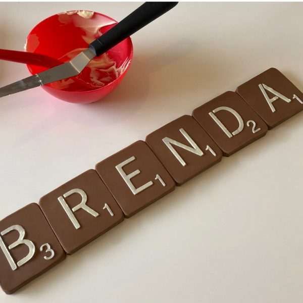 "40g milk chocolate letters spelling out ""BRENDA"" measures 6cm square by 1cm thick"