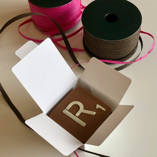 milk chocolate letter R in small white box with pink and brown raffia ribbons