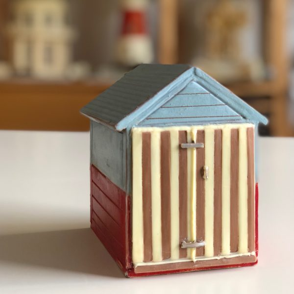 250g of delicious milk chocolate painted with edible food colourings make this 7cm tall beach hut unique with vertical striped front doors create your own mini Brighton beach hut