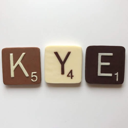 milk white and dark chocolate letter squares 6cm spelling KYE