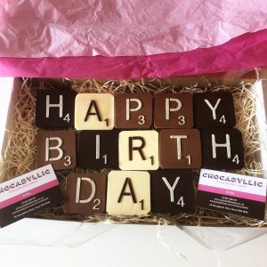 "dark, milk and white chocolate letters reading ""HAPPY BIRTHDAY"" each square measures 6cm square by 1cm thick and weighs 40g"